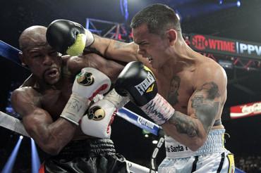 Floyd Mayweather could fight Amir Khan
