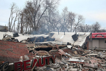 A town ravaged by anger: Before and after pics show Ferguson damage