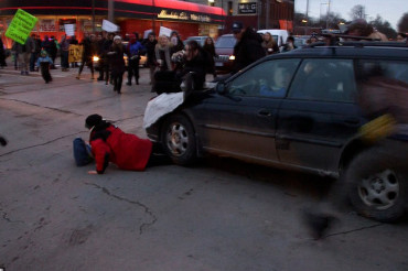 Hit-and-run driver smashes through Ferguson protesters, drags woman 20 feet