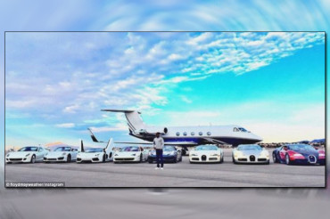 Floyd Mayweather poses by his multi-million dollar super fleet