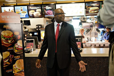 McDonald's CEO steps down as the world's biggest hamburger chain battles 'hip' chains