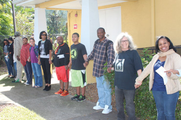 Human chain surrounds the Woodson Museum