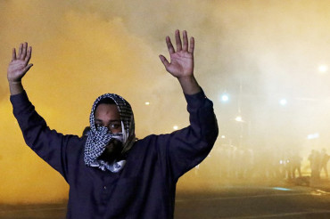 Violence erupts in Baltimore: Police use tear gas and rubber bullets to enforce curfew