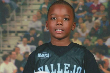 Young boy, 8, critically injured in drive-by shooting celebrates birthday in a hospital bed