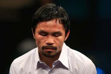 Battered Manny Pacquiao narrowly loses fight of the century to Floyd Mayweather