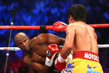 Floyd Mayweather defeats Manny Pacquiao doing what he does best: Being elusive