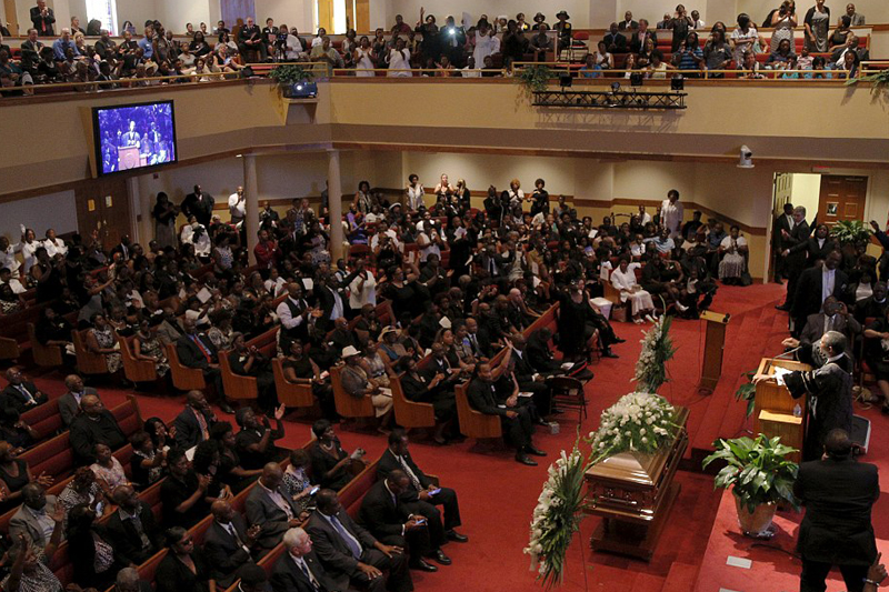 Heartbreaking scenes as mourners bury victims of race-hate church massacre