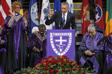Obama's amazing grace: President gives searing speech on race, leads church in song during emotional eulogy