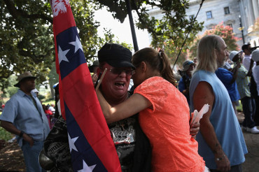 Angry clashes in South Carolina between Klu Klux Klan and New Black Panther Party on Confederate flag