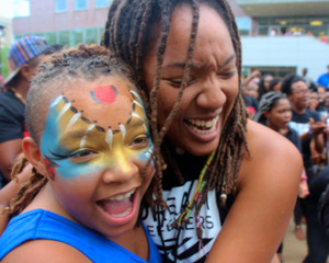 Asha Starks of the Dream Defenders embraces a young conference participant.