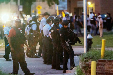 St. Louis police fatally shoot 18-year-old black suspect sparking Black Lives Matter protest