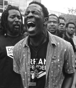 Demetrius Vaughn leads the crowd in a chant.