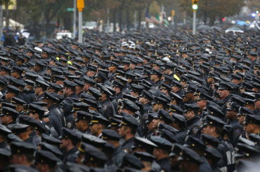 Thousands of cops line streets for funeral of fourth NYPD officer shot dead in line of duty