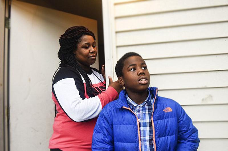 10-year-old boy: Unarmed black man handcuffed when shot by police