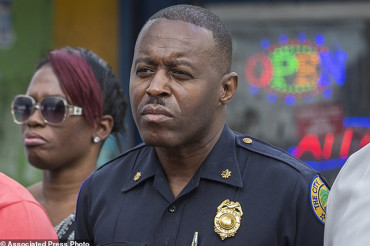 Ferguson appoints new black police chief to heat up embattled police department