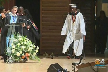 Teen paralyzed from waist down in shootings stuns classmates by walking across graduation stage