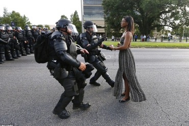 'This is the work of God. I am a vessel.' NYC nurse behind powerful protest photo in Baton Rouge