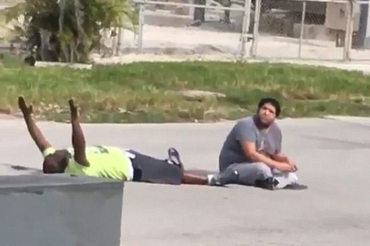 Unarmed black therapist shot by police while attempting to calm autistic patient