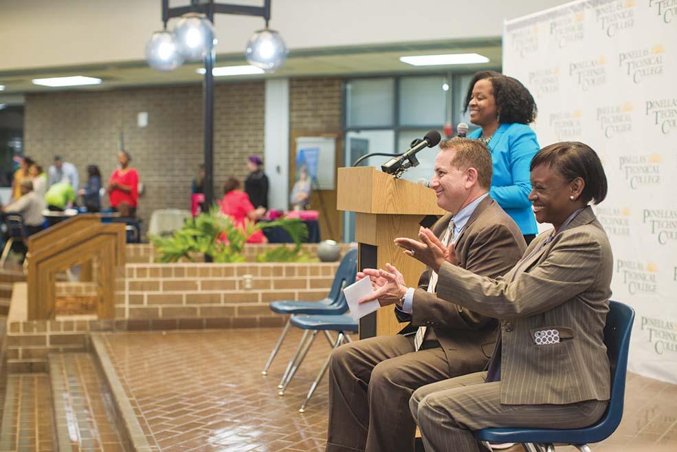 Nikki Gaskin-Capehart, at podium, Mayor Rick Kriseman and Deputy Mayor Kanika Tomalin kicked off the CRA career fair
