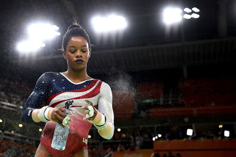 Gabby Douglas Only Has 1 Job—and It Isn't to Fix Her Hair to Please You