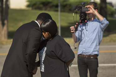 Family of black teen killed by white cop agrees to $1 million settlement