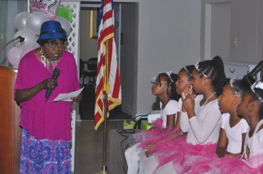 Little Miss Pink Petals dance with fathers at Princess Tea Party