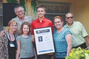 Jonas Giangrosso, center, and family
