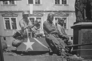 Members of an African-American tank battalion prepare to clear out enemy positions in Coburg, Germany, in April 1945. The 761st Tank Battalion saw 183 consecutive days of combat while attached to General George Patton's Third Army.