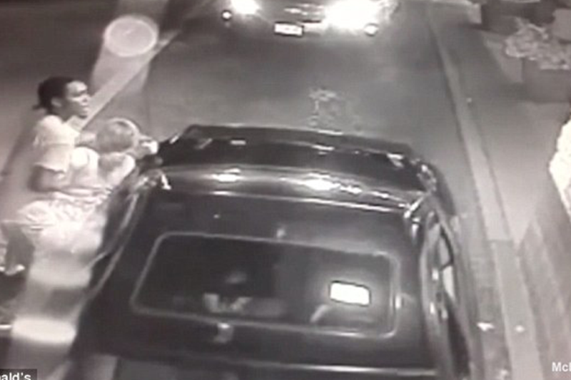 Mom tries to hand toddler to McDonald's drive thru worker as she battles child's father who had abducted them