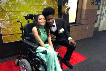 High school football star becomes Internet sensation after taking disabled best friend to prom