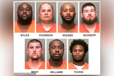 Seven bounty hunters charged with murder after opening fire on WRONG car at Walmart