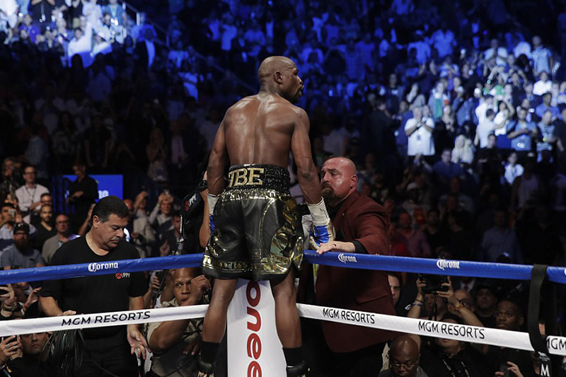 Floyd Mayweather stops Conor McGregor in the 10th round to reach landmark 50-0 record