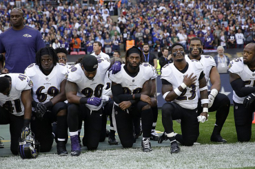 130 NFL stars kneel or sit during anthem in defiance of Trump: Hundreds more including Brady link arms in solidarity