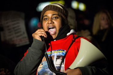 Eric Garner's activist daughter clinging to life after asthma triggered heart attack, leaving her with 'major brain damage'