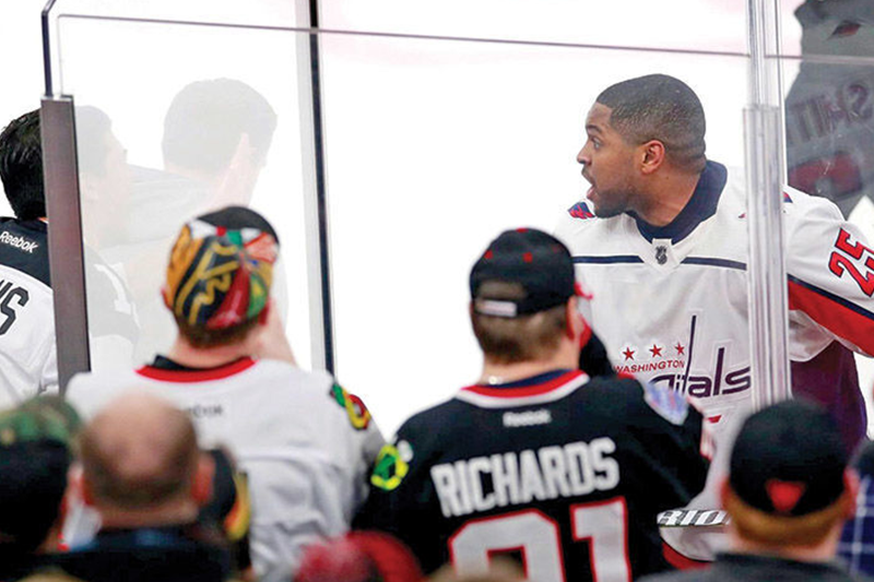 Racists don't have a ball (or puck) when black athletes challenge them