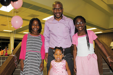 Daddy-daughter dance offers a party with a purpose