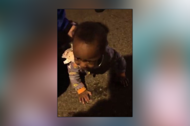 Mom charged with child endangerment after her 9-month-old child filmed crawling across busy road