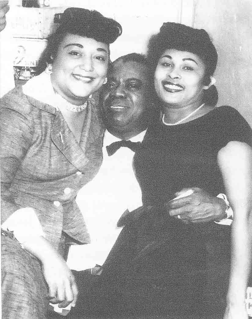"Louis ""Satchmo"" Armstrong takes a break from a Manhattan Casino gig in the company of two fans, Josephine Smith, left, and Esther Peck Thomas. Courtesy John L. Smith Jr."
