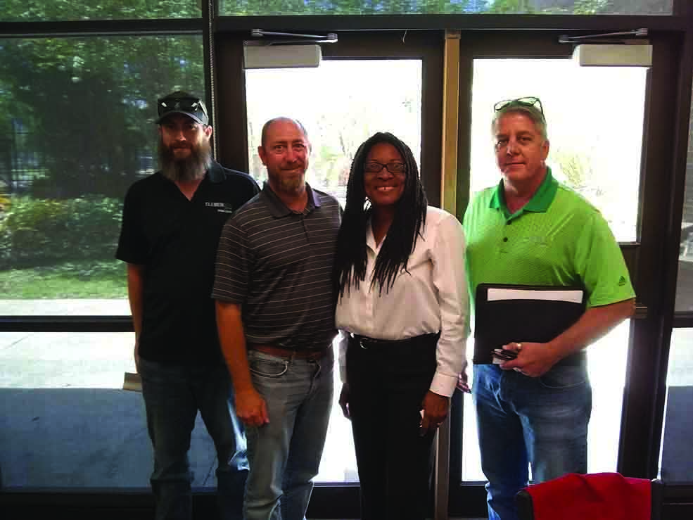 L-R, Travis Eustice and Michael Richardson from Element Engineering Group, LLC with Faye Watson and DuWayne Tison, also from Element Engineering