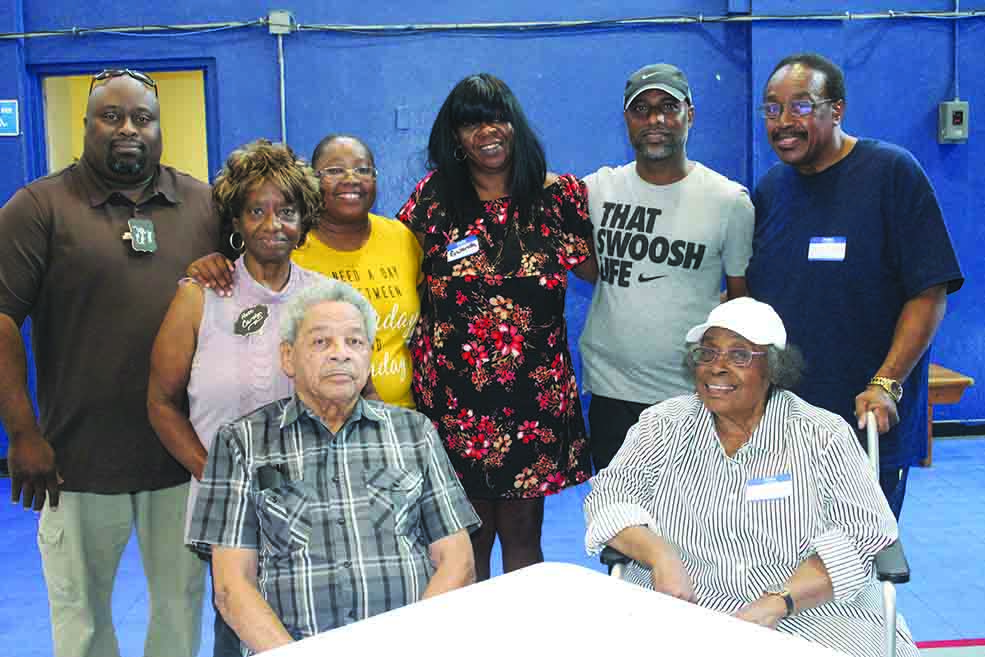 Standing L-R, Brian, Carolyn, Robin, Gwanda, Johnnie and MichaelSeated: Poole family patriarch Albert Poole and matriarch Mildred Grier Landers