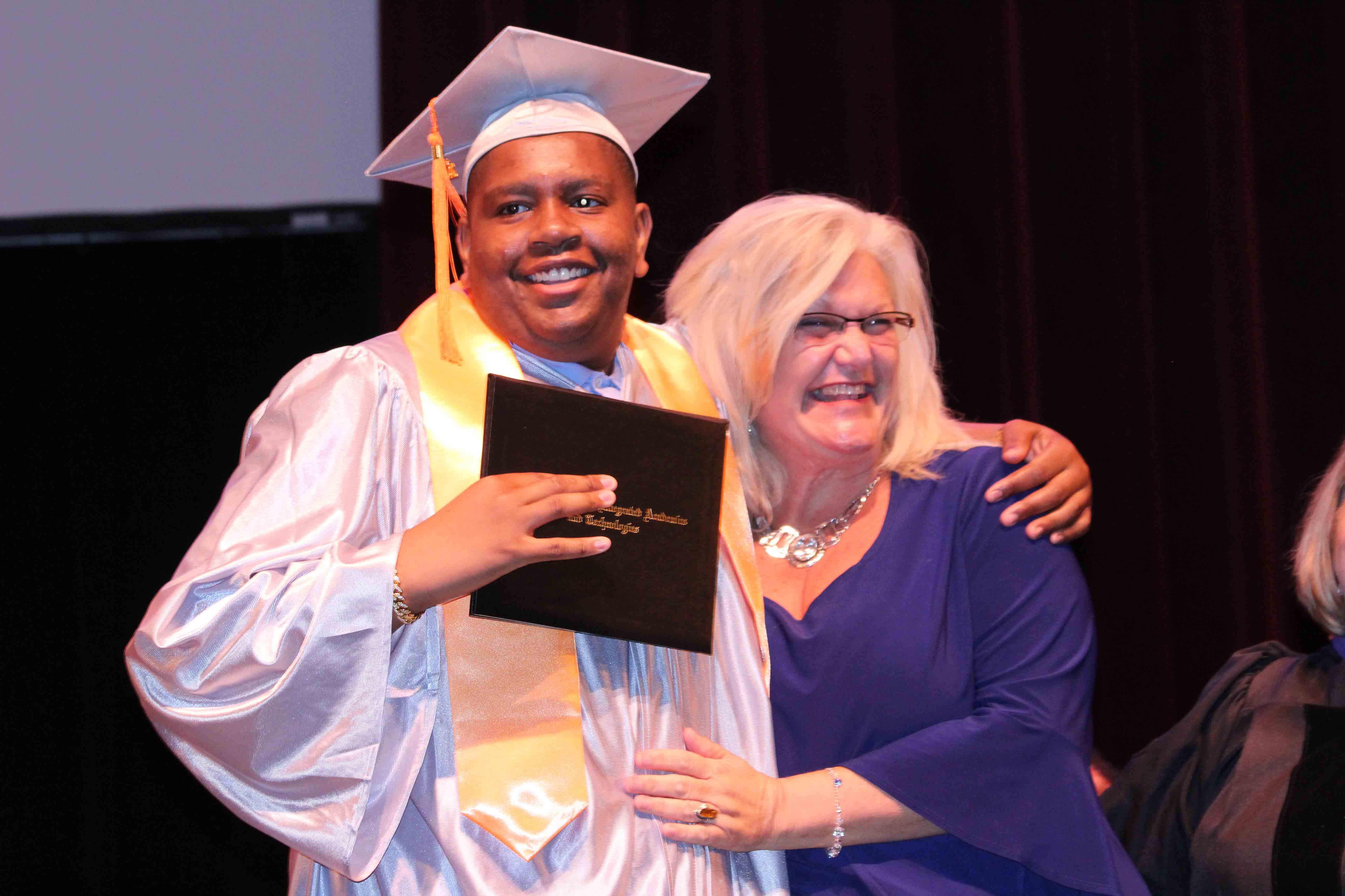 Davion Only-Going posing with his mom, Connie Going, after receiving his high school diploma