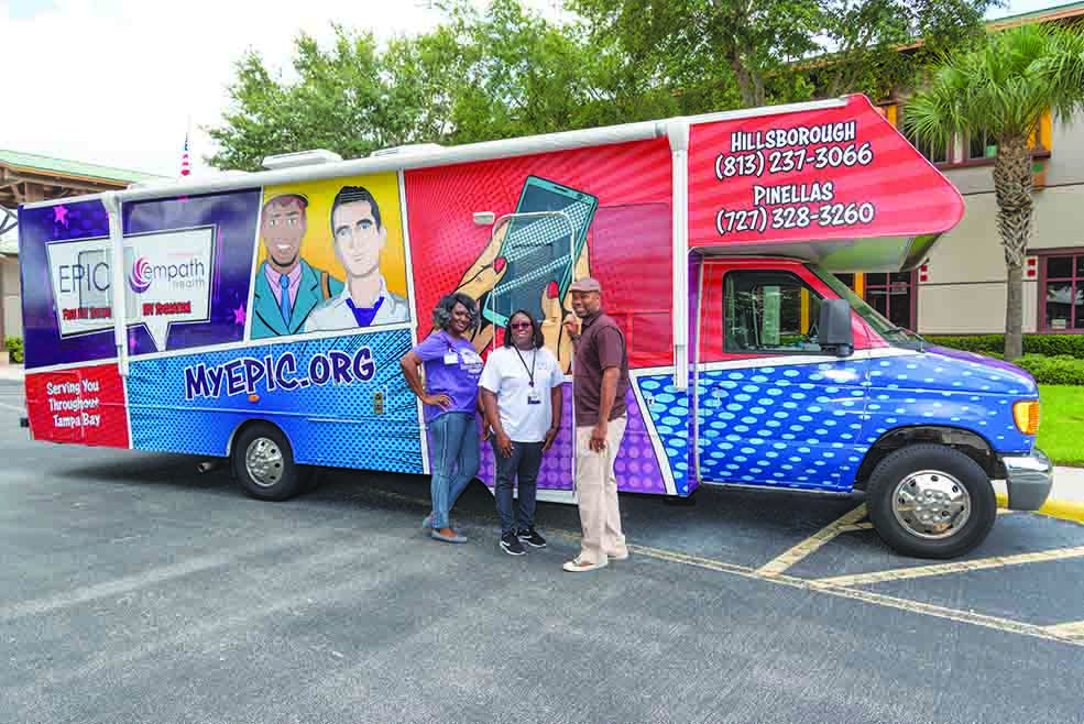 L-R, Keayea Lee, Michele Watkins and Dartange Scott – Educational Outreach and Testing Staff for EPIC standing in front of EPIC's Mobile Testing Unit, which brings rapid HIV and STD testing throughout the Tampa Bay Area.