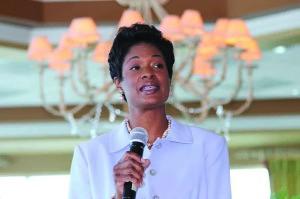 Angela moderating the 2014 Juvenile Welfare Board Children's Summit.